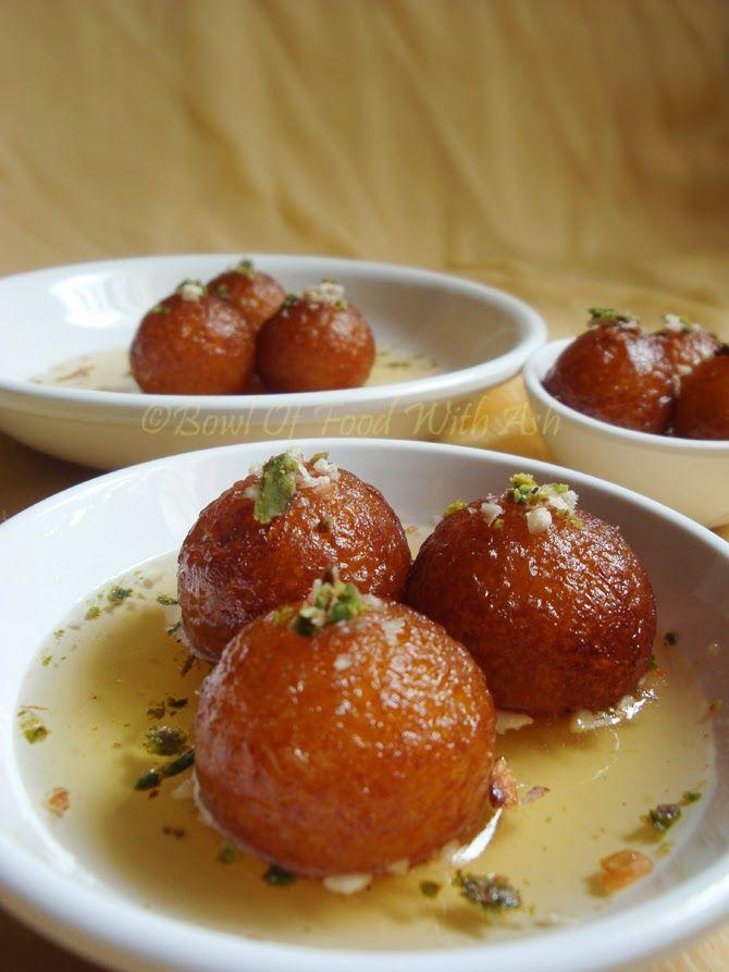 Gulab Jamun - deep fried dumplings made with milk powder soaked in sugar syrup.
