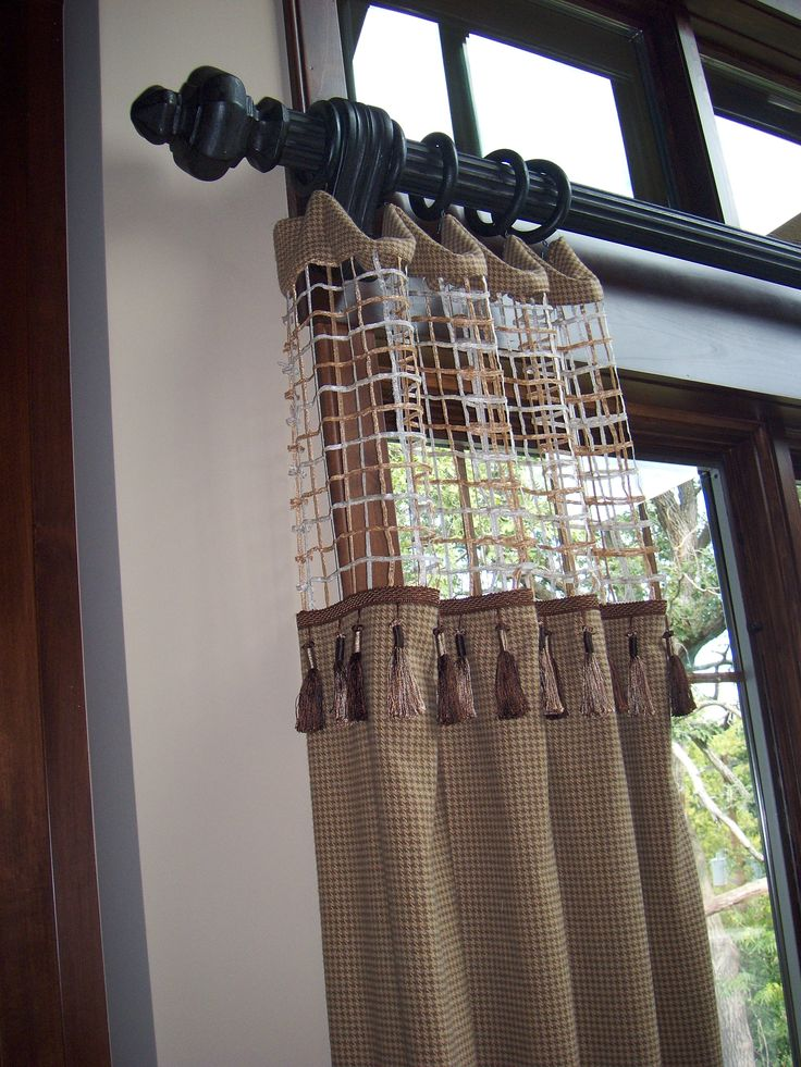 For added interest and ability to let the light in use a sheer top fabric on these drapery panels.