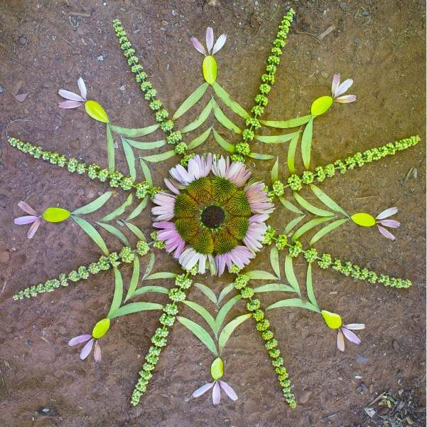 Nifty! I already do this w/ rocks and stones all the time, never thought to do it with leaves, flowers etc...from Bohemian Pages: Earth Mandalas