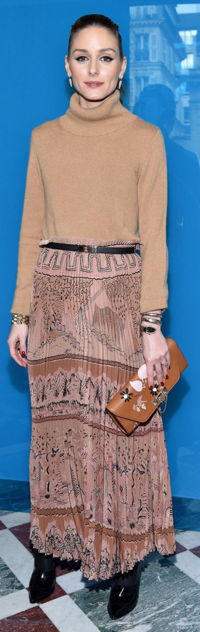 Who made  Olivia Palermo's pink print pleated maxi skirt, gold watch, and brown clutch handbag?
