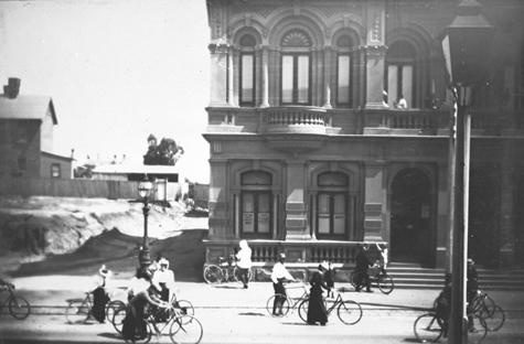 Negative - Cyclists in High Street, Northcote, Victoria, 1898