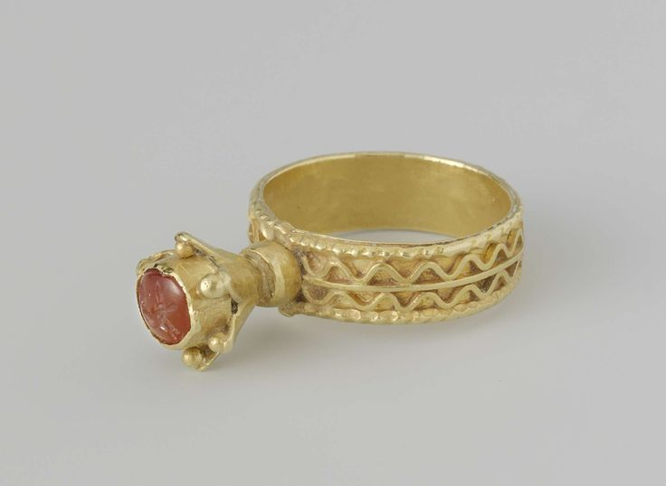 Ring of gold: In a tall cabinet in the shape of a chalice, a carnelian intaglio, 500-700 A.D.