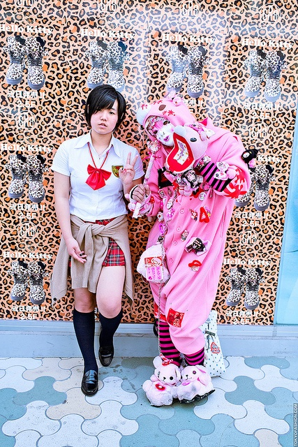 The famous(?) masked Gloomy Bear of Harajuku posing with a Japanese schoolgirl(?) in front of a display for leopard print Hello Kitty sneakers at LaForet Harajuku.