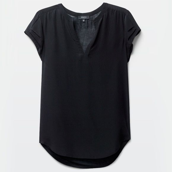 Shop Women's Aritzia Black size S Tees - Short Sleeve at a discounted price at Poshmark. Description: Aritzia black silk shirt with cotton-jersey back. Great condition besides a couple tiny marks near the hem.. Sold by jullliana. Fast delivery, full service customer support.