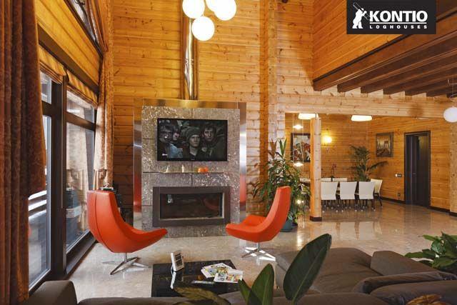 Séjour avec cheminée dans un chalet en bois KONTIO en Russie.  http://www.kontio.fr/