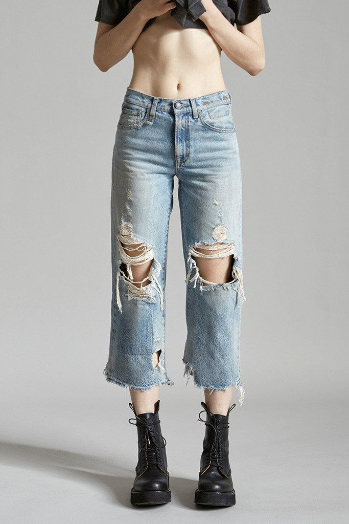 - High Rise Cropped Straight Leg - Classic Five Pocket Styling - Heavily Distressed Light Blue Wash - Large Rips at Knee - Distressed Hem - 100% Cotton - Machine Wash - Made in Italy - R13W1353-200