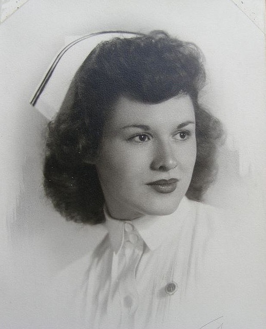Studio portrait of a beautiful 1950s nurse. This is how I remembered nurses. The caretaker of those in need.