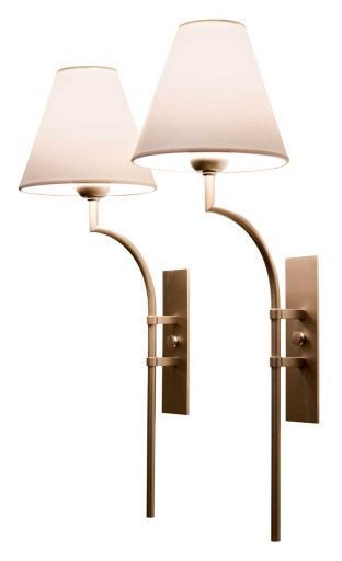 Love that these lamps have a touch of the old with a sharp twist.  Beautiful sconces ............ John Saladino Wall Sconce - something slim and simple in living room