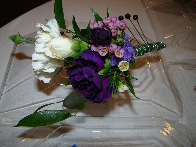 Bout to mimic bouquet .....   Always important when deciding on bout elements is to ensure that it has elements common to the bouquets. This is an example of that philosophy as you will see when looking later at the bride's bouquet.This design done by grandbeginningsdecor