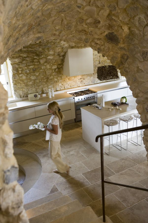 Modern kitchen seems to be in a stone cave
