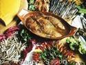 """Tinca al forno di Clusane:     la Tinca è un pesce di acque basse, facile da pescare. e i pescatori iniziarono a vendere e cucinare nelle osterie il pesce che avevano in eccedenza, dando così il via alla tradizionale ricetta della """"Tinca ripiena al forno con polenta"""". Col passare del tempo alle osterie tradizionali si affiancarono i primi ristoranti connotando Clusane, già alla fine dell'800, come il """"Paese della Tinca al Forno"""""""