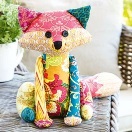 Who wouldn't want their own patchwork fox friend? Anthea Christian's fox softie pattern uses a range of bright fabrics to create the scrappy, patchwork look.