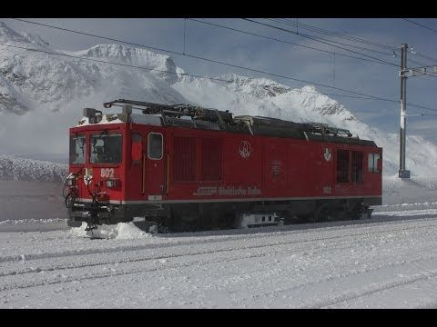 If you love the Swiss railway network, and enjoy the snow, this is the video to watch.   ▶ [HD] Berninapass im Winterkleid--- Schneeräumung gestern und heute - YouTube