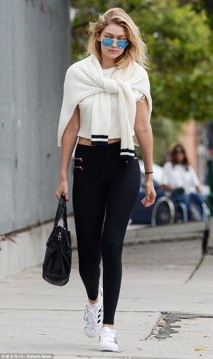 Gigi Hadid wearing Blue Life Fit Zipper Moto Leggings, Maxmara Whitney Small Tote Bag and Adidas Originals Superstar Sneakers