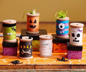 Halloween Spool Figurines  Design by Lisa Storms  Create whimsical characters using wooden spools wrapped in embroidery floss. Add stickers and cardstock for eyes and mouths to turn the spools into Halloween creatures.