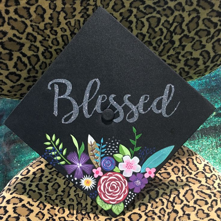 """""""BLESSED"""" gray glitter with hand-painted graduation cap of flowers and feathers"""