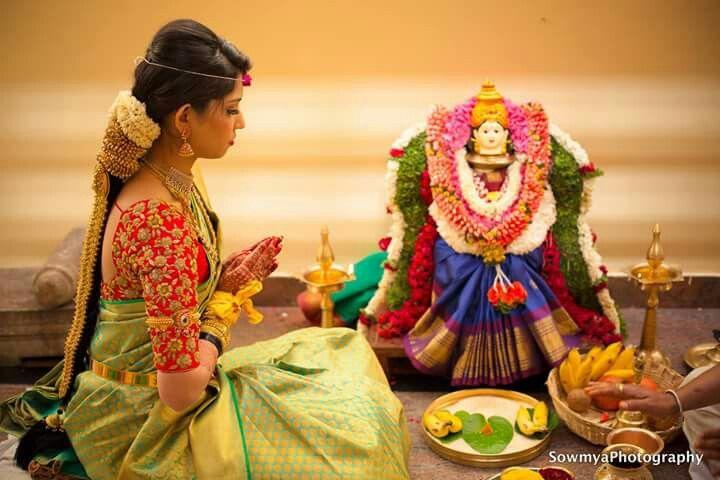 South Indian bride. Temple Indian bridal jewelry. Jhumkis.Green silk kanchipuram sari with contrast red embroidered sleeve blouse.Braid with fresh jasmine flowers. Tamil bride. Telugu bride. Kannada bride. Hindu bride. Malayalee bride.Kerala bride.South Indian wedding.Gowri puja.