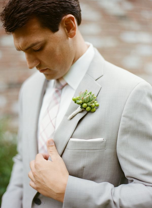 This groom looks so great in his light gray with a touch of pink wedding suit.