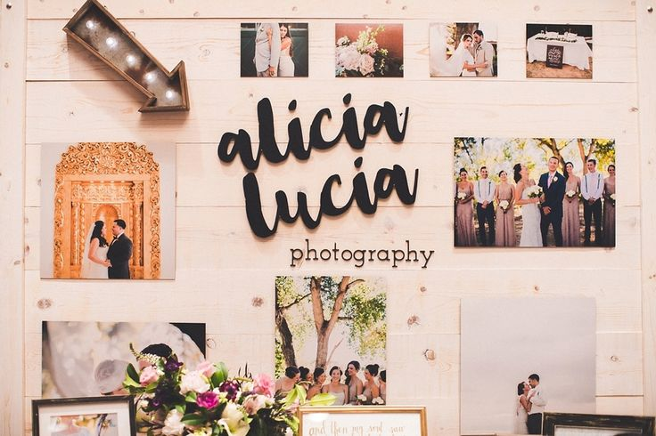 Wedding show booth inspiration // wedding show booth for photographers // bridal show booth // garland // laser cut logo // weathered wood backdrop
