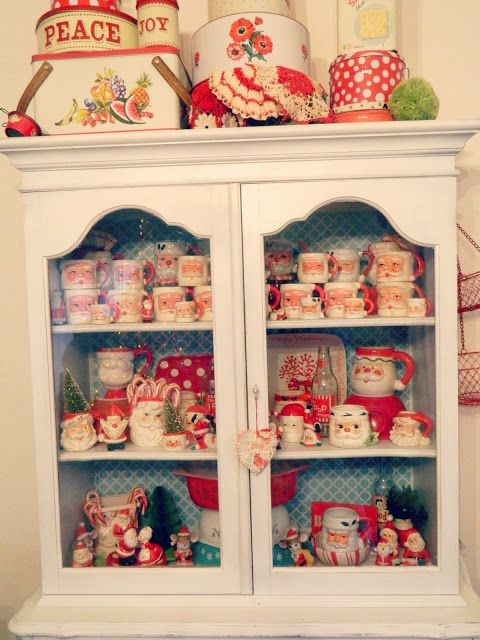 what a cute little cupboard of santas . . .