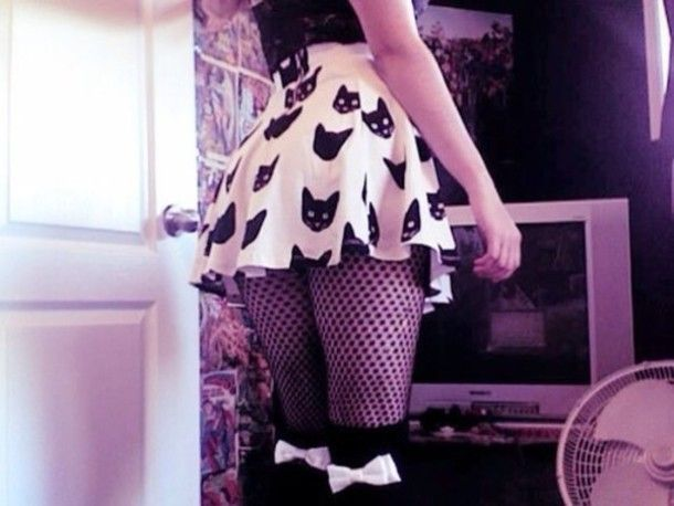 skater skirt with cat print, fishnets. pastel goth, but I can dig it.