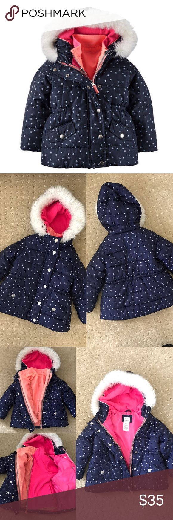 Carters 2T 4-in-1 Jacket System in Navy Carters size 2T 4-in-1 jacket system. Navy blue with white star print and faux-fur trimmed hood. Zip front + snap button closure. Bright pink and orange inner fleece jacket. Pockets on both outer parka and both sides of inner jacket. Worn a handful of times and in very good and clean condition. 100% polyester shell, lining and fill. Comes from a smoke-free home. 4 ways to wear it: 1. Outer parka jacket 2 & 3 Reversible inner fleece jacket 4. Zip them…
