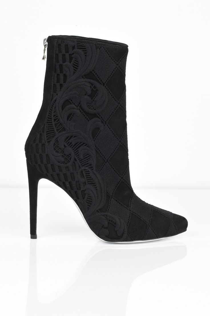 Balmain suede leather ankle boot in black. Embroidered pattern over suede…