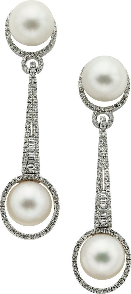 Cultured Pearl, Diamond, White Gold Earrings feature cultured pearls measuring 9.80 x 9.90 mm, enhanced by full-cut diamonds weighing a total of approximately 1.15 carats, accented by baguette-cut diamonds weighing a total of approximately 0.20 carat, set in 14k white gold