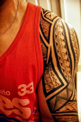 Shoulder/Sleeve - Polynesian pattern, bold borders and negative space..
