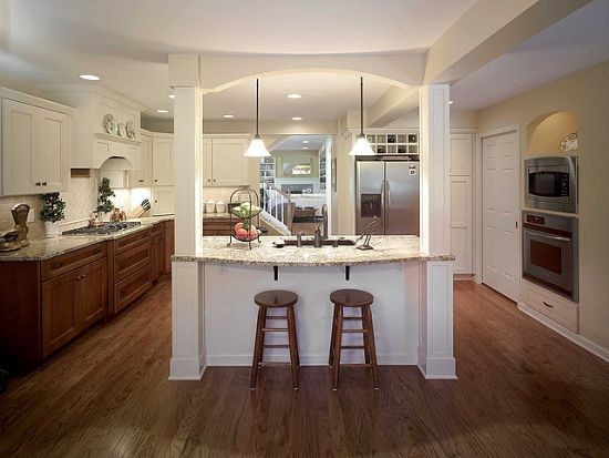 Granite was used for the island and perimeter counters in this transitional-style kitchen by McClurg.