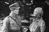 "fINNISH fILM iNDUSTRY (LIKE ALL OTHER COUNTRIES AS WELL) PRODUCING WAR CiNEMA DURING WW2: Tauno Palo & Ansa Ikonen in Serenaadi Sotatorvella (""sERENADE FOR WAR BUGLE""), 1940."