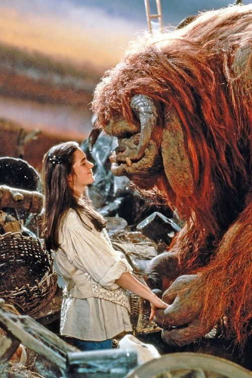 Sarah Williams, played by Jennifer Connelly, and Ludo in Jim Henson's Labyrinth (1986).