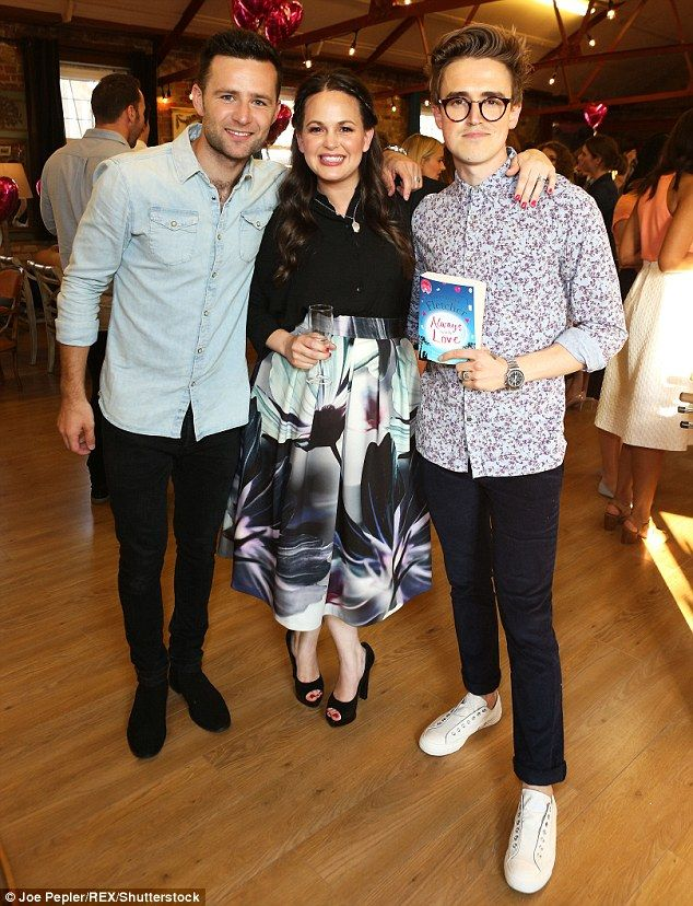 Night out: McFly drummer Harry Judd (left) joins his bandmate Tom Fletcher (right) and his wife Giovanna at the launch of her latest novel in London on Monday night