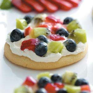 Sugar Cookie Fruit Pizzas Recipe-made this for my daughters girl scout snack and they all loved these, especially the cream topping. It's my new go to whipped topping/frosting - (double batch)1 pack 8oz cream cheese, beat together with 1/2 cup-3/4 cup powdered sugar(to taste), then fold in one reg tub of thawed cool whip.
