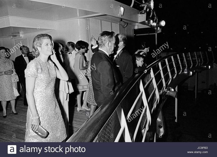 The Monegasque Princely Family attending a soirée organised by Begum Om Habibeh Aga Khan (Yvette Labrousse): Grace of Monaco and Rainier III on the deck of the ship. c.1965 Photo Michael Holtz
