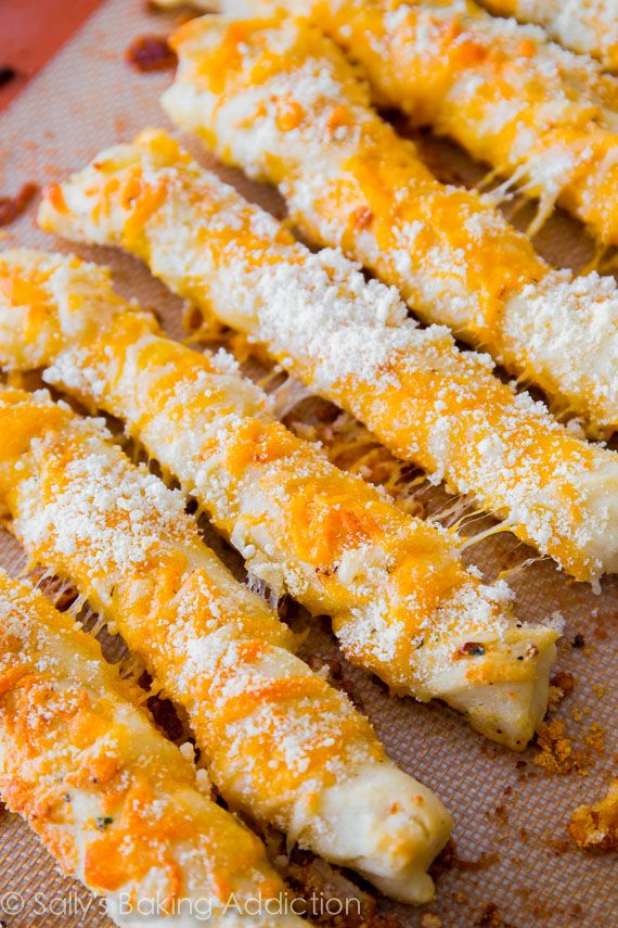 Super cheesy garlic breadsticks made from scratch. Soft & fluffy, your family will love them!