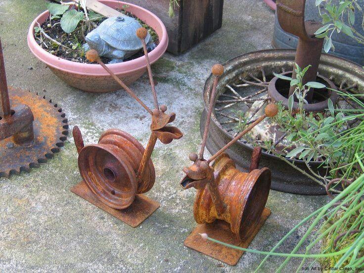 yard art ideas from junk | Garden snails made from junk
