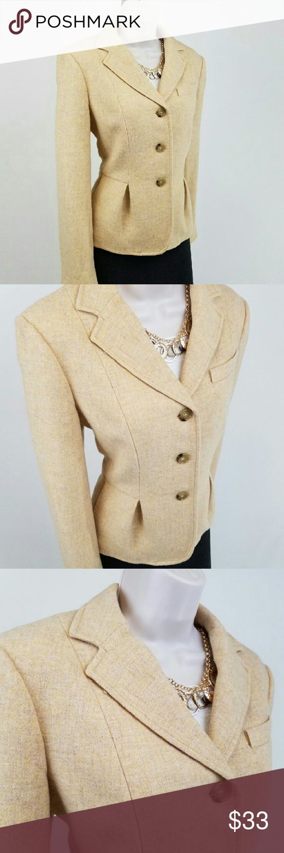 Pale yellow wool blazer Talbots Grace Fit wool blazer in shortbread cookie yellow.  Features long sleeves with slit cuffs, three-button closure, single breast pocket, 2 on-seam pockets, a pleated peplum, and light shoulder pads.  Fully lined.  Refined and beautifully tailored.  Bust 19 / waist 17.5 / length 23 inches.  100% wool; lining 100% polyester.  Thanks for visiting my closet; come back soon & see what's new!  I add listings every week! Talbots Jackets & Coats