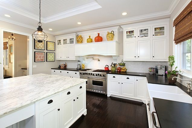 White Kitchen With Honed Calcutta Marble Island And Honed