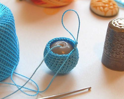 Crochet around a bead.