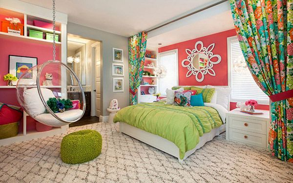 20 Bedroom Paint Ideas For Teenage Girls | The vibrant coral walls create an exciting backdrop for the pops of other bold colors in this room. It accentuates the appealing patterns, striking colors and textures, perfect for a young, spirited teen