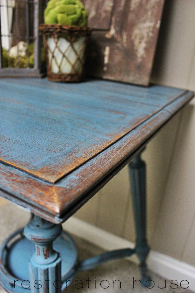 Cleaned with TSP, painted with MMSMP in French Enamel, distressed with a putty knife and sanding sponge, finished with dark wax