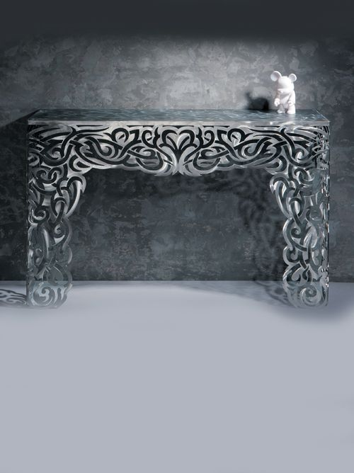 """An imposing and somewhat theatrical console. Fretwork like lace cut out of stainless steel creating a truly magnificent table. These items are authenticated """"one-off"""" pieces made in limited numbers and stamped editions."""