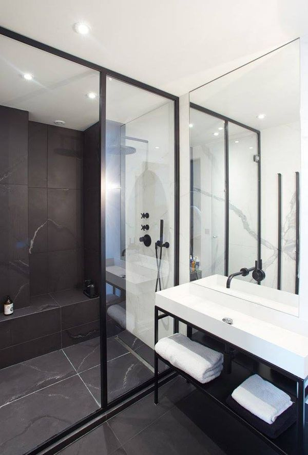 The inset bench seat and large format tiles provide simplicity and style to this open walk in shower