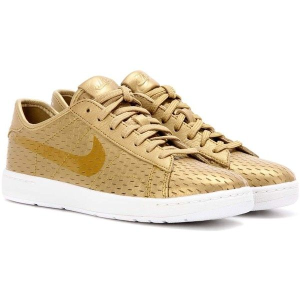 Nike Nike Tennis Classic Ultra Leather Sneakers (£110) ❤ liked on Polyvore featuring shoes, sneakers, gold, leather trainers, real leather shoes, tenny shoes, leather footwear and nike