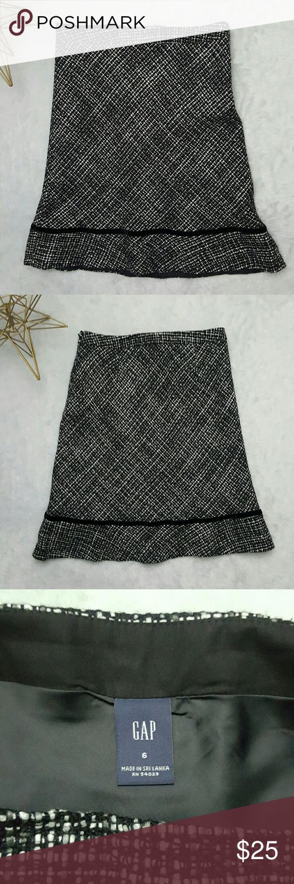 Gap Tweed  Trumpet Skirt Size 6 Gap trumpet skirt in tweed material and velvet trip at bottom. Size: 6 Color: black and white   Gently used. Great condition. GAP Skirts