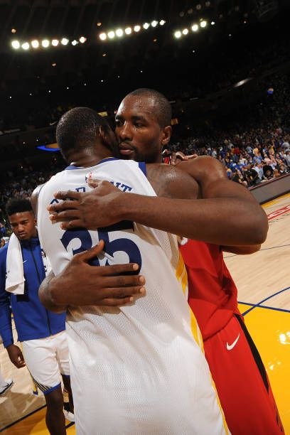 Kevin Durant of the Golden State Warriors and Serge Ibaka of the Toronto Raptors hug after the game on October 25 2017 at ORACLE Arena in Oakland...