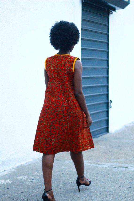 African Print dress, knee length dress.  This dress can be worn on its own as shown in the picture or with a jean jacket or black blazer- your pick!  CARE INSTRUCTIONS: Dry Clean Recommended DO NOT BLEACH Press with warm iron on the wrong side only.