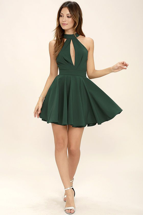 You'll make a charming debut when you step out in the Smile Sweetly Forest Green Skater Dress! A halter neckline (with buttoning back) tops a pleated bodice, with sultry front and back cutouts. Woven poly skirt flares into a flirty silhouette below a fitted waist. Hidden back zipper.