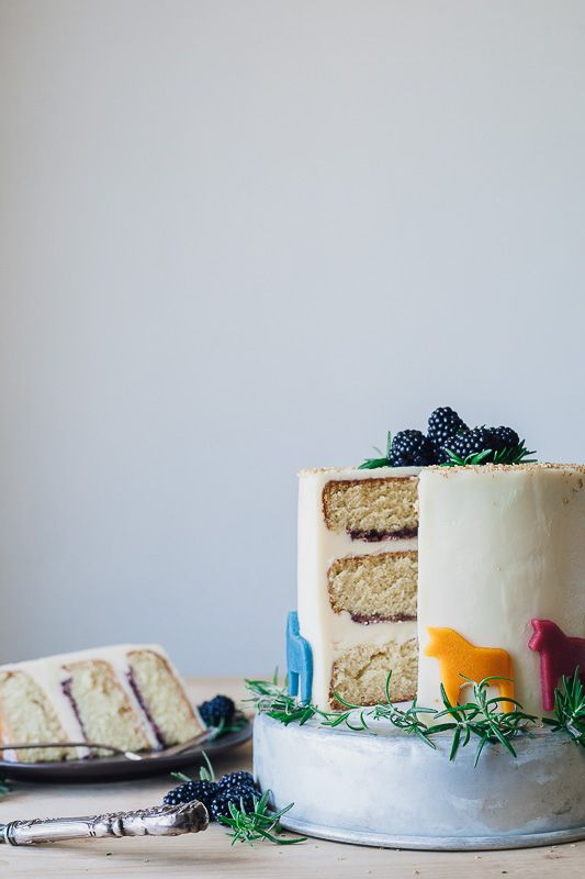 rosemary vanilla cake with blackberry preserves, mascarpone frosting, and marzipan dala horses | my name is yeh
